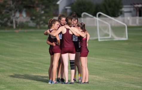 THS women's cross-country team shows camaraderie.