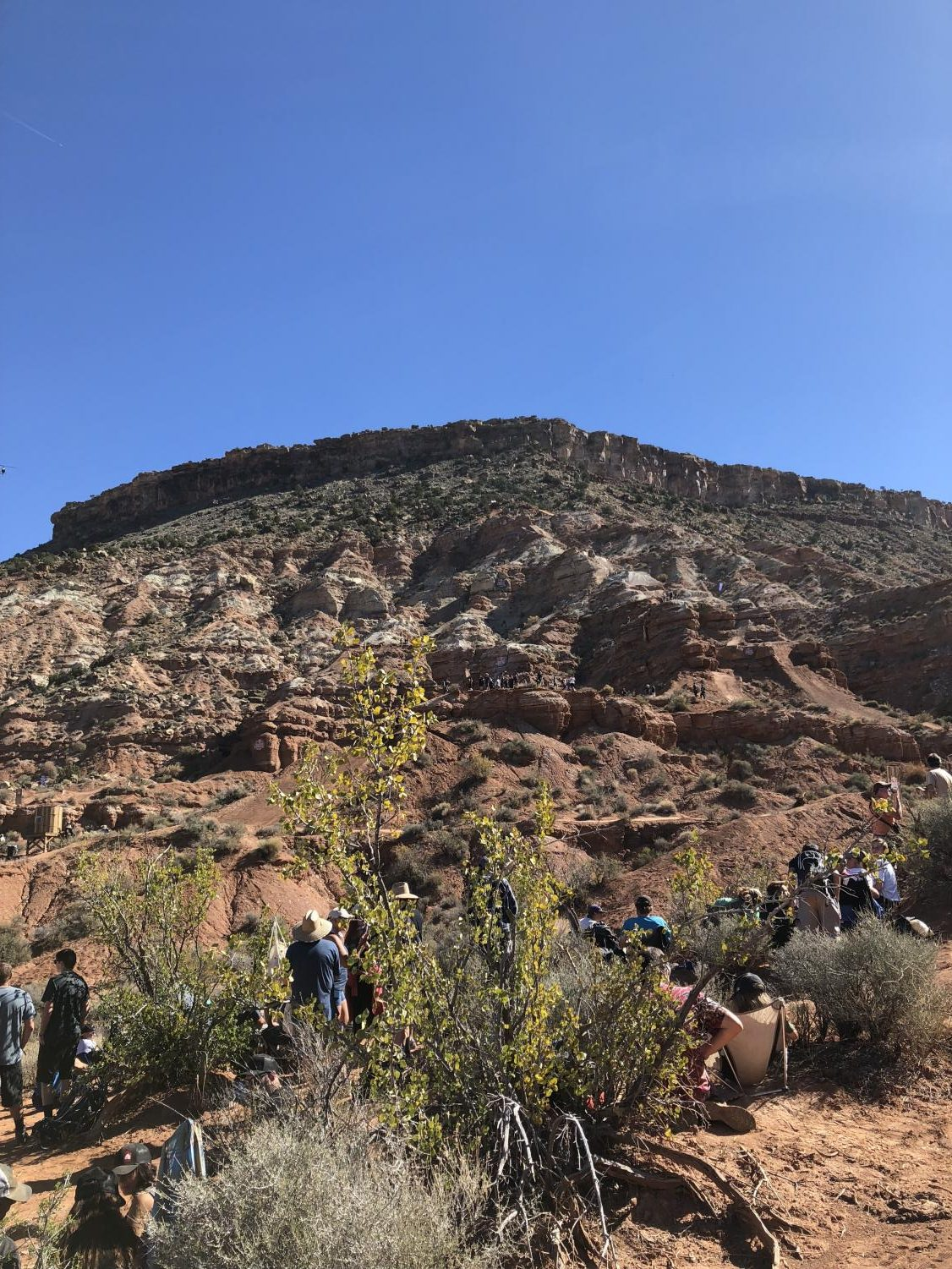 Fan stood by and watched as Red Bull Rampage athletes tore down a rocky face.
