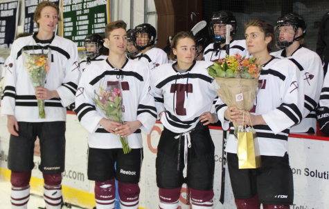 Senior hockey athletes celebrate an end to their high school hockey career.