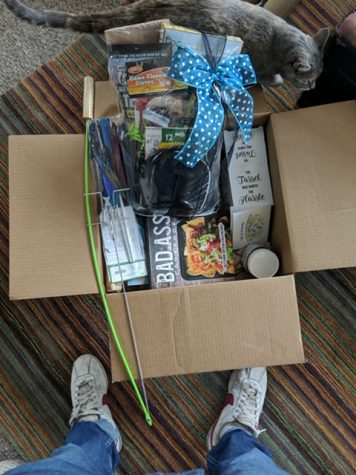 "Telluride High School senior, Roc Repola, opens his ""adopt-a-senior"" package and finds lots of his favorite goodies."