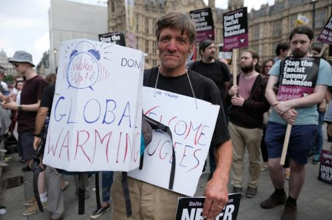 A man protesting outside of parliament.