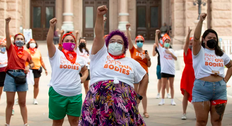 A+group+of+Texas+women+protest+the+recent+abortion+law.
